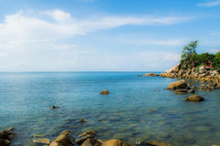 Beautiful Bay and Beach with Rocks, Palms and a Hut, Thailand Stock Images