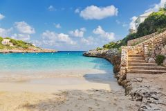Beautiful bay beach turquoise sea water.Mallorca island. Beautiful sand beach bay of Cala Mandia. Porto Cristo. Mallorca island, Spain Mediterranean Sea Stock Image