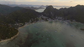 The beautiful bay with boats at sunset. Aerial view. stock video footage