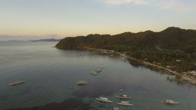 The beautiful bay with boats at sunset. Aerial view. stock footage