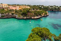 Beautiful bay of Cala Ferrera with turquoise water and villas in Cala d`Or, Mallorca. Spain Stock Images