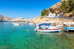 Beautiful bay with greek traditional white chapel in Lindos, Rhodes island, Greece. Amazing view on greek island Rhodes on Dodecanese royalty free stock images