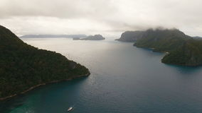 The beautiful bay with mountains rocks aerial view. Tropical islands. stock footage