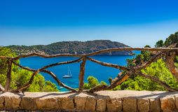Beautiful bay with sailing yacht on Majorca island, Spain. Beautiful sea view of bay with boat at the idyllic bay in Camp de Mar on Mallorca island, Spain Stock Photo