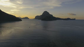The beautiful bay at sunset. Aerial view. Tropical bay in El Nido sunset. Aerial view: tropical landscape. Sunset sky and mountains rocks of bay. Dreamy sunset stock video