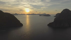 The beautiful bay at sunset. Aerial view. Tropical bay in El Nido sunset.Aerial view:tropical landscape.Sunset sky and mountains rocks of bay.Dreamy sunset stock video footage