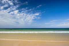 Beautiful beach. With a nice and beautiful cloudy sky stock images