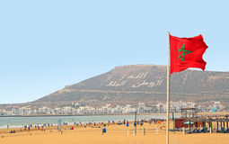 The beautiful beach in Agadir. With flag of Morocco Stock Images