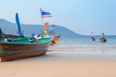 Beautiful beach against seaview with fishing boats dock  at kata beach, Phuket, Thailand Stock Photo