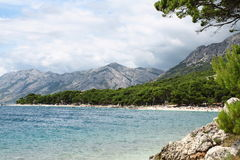 Beautiful beach. With amazing mountains in summer Royalty Free Stock Image