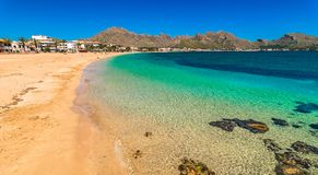 Beautiful beach in bay of Pollensa on Majorca island, Spain. Mallorca beach, beautiful seaside at bay of Pollenca, Spain Mediterranean Sea Royalty Free Stock Image