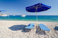 Relaxing time in Afandou beach on Rhodes island in Greece. Beautiful beach with blue sea on Rhodes island in Greece royalty free stock photos