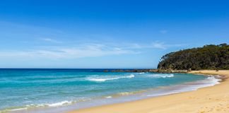 Beautiful beach with blue sky in New South Wales Australia. Ocean waves and blue sky royalty free stock photo