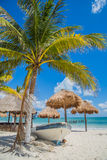 Beautiful beach. Boat on the beach under a palm tree Mexico, Carribean Royalty Free Stock Image