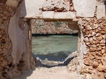 The ruins of a fisherman`s house Mallorca. Beautiful beach in Cala Brafia with the ruins of a fisherman`s house in Mallorca Stock Photo