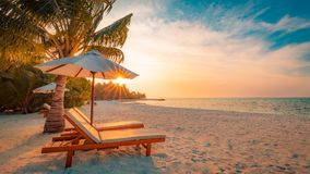 Beautiful beach. Chairs on the sandy beach near the sea. Summer holiday and vacation concept. Inspirational tropical scene. Tranquil beach scene. Exotic Royalty Free Stock Images