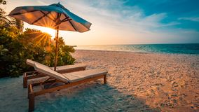 Beautiful beach. Chairs on the sandy beach near the sea. Summer holiday and vacation concept. Inspirational tropical scene. Tranquil beach scene. Exotic Stock Photos
