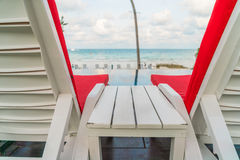 Beautiful beach chairs with umbrella around outdoor swimming poo Royalty Free Stock Images