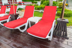 Beautiful beach chairs with umbrella around outdoor swimming poo Royalty Free Stock Photography