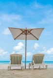 Beautiful beach chairs with umbrella on tropical white sand beac Royalty Free Stock Photography