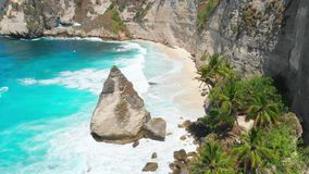 Beautiful beach with cliff on Nusa Penida Island. Aerial drone view of tropical landscape. Beautiful beach with cliff on Nusa Penida Island. Aerial drone view of stock footage