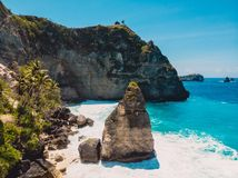 Beautiful beach with cliff on Nusa Penida Island. Aerial drone view of tropical island stock image