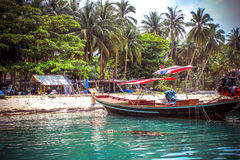 Beautiful beach with coconut trees and boats at Stock Photos