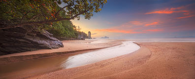 Beautiful beach with colorful sky, Thailand. Beautiful beach with river and colorful sky at sunrise or sunset, Thailand Royalty Free Stock Image