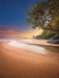 Beautiful beach with colorful sky, Thailand. Beautiful beach with river and colorful sky at sunrise or sunset, Thailand Stock Photo