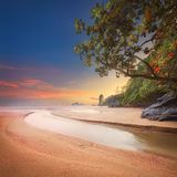 Beautiful beach with colorful sky, Thailand. Beautiful beach with river and colorful sky at sunrise or sunset, Thailand Royalty Free Stock Images