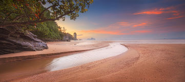Beautiful beach with colorful sky, Thailand. Beautiful beach with river and colorful sky at sunrise or sunset, Thailand Stock Photos