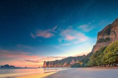 Beautiful beach with colorful sky, Thailand Stock Images