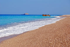 Long empty beach. Beautiful beach with crystal clear blue sea,and interesting small stones,Greece Stock Photo
