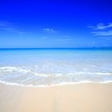 Beautiful beach with crystal clear blue water Stock Photos