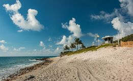 Beautiful Beach Day On Jupiter Island Florida. An empty beach on a beautiful morning at Jupiter Island, blue skies with white puffy clouds stock image