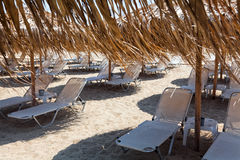 Beautiful beach with deck chairs and umbrellas Royalty Free Stock Photography