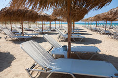 Beautiful beach with deck chairs and umbrellas Royalty Free Stock Photo