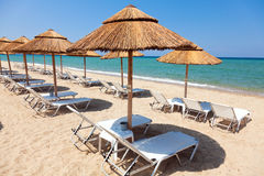 Beautiful beach with deck chairs and umbrellas Stock Image