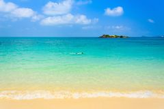 beautiful beach with Diver man on blue sea and blue sky stock photo