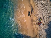 Beautiful beach with family top view shot stock images