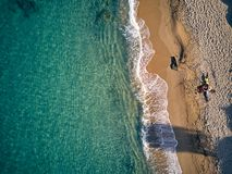 Beautiful beach with family top view shot stock photography