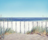 Beautiful Beach, Fence and Blue Sky Royalty Free Stock Photography