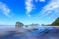 Beautiful beach with fisherman boat Royalty Free Stock Photos