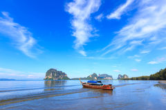 Beautiful beach with fisherman boat Stock Images