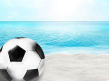 Beautiful beach football soccer ball 3D ball sand water background Royalty Free Stock Photos