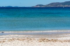 Beautiful beach French Riviera with blue water and white sand, v. Acation destination Royalty Free Stock Photo