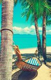 Beautiful beach. Hammock between two palm trees on the beach. Ho Royalty Free Stock Photos