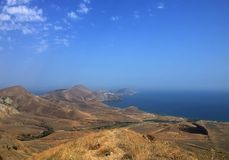 Beautiful beach, hills, sea and sky. Coast stretching into the distance Stock Image
