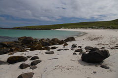 Beautiful beach on the Isle of Barra. A beautiful sandy and rocky beach on the Isle of Barra in The Outer Hebrides Stock Photos