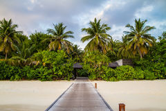 Beautiful beach with jetty at Maldives Stock Images